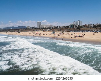 People enjoying Santa Monica beach in California
