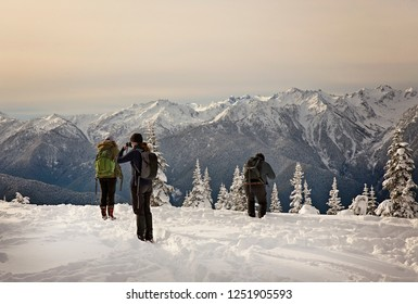 People enjoying the snow covered mountains in washington state in the Olympic National Park