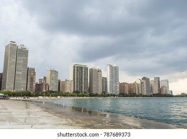 People enjoying a summer day at Oak Street Beach, Chicago, IL, USA on the 4th August, 2017