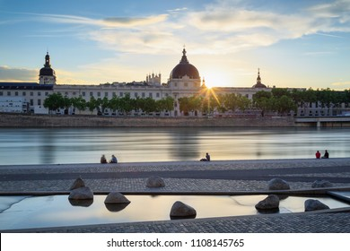 People enjoying a summer sunset at the Rhone river in Lyon.