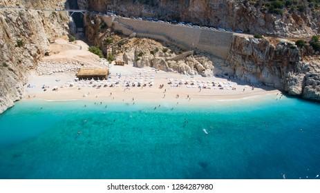 People enjoying sun and sea at the beautiful turquoise sea and sandy beach of Kaputas. aerial drone shooting. Mediterranean, Kas / Antalya - TURKEY