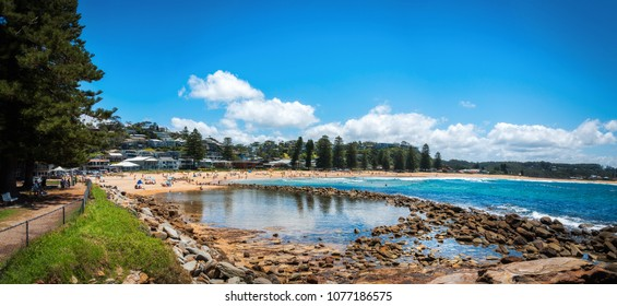 People enjoying a sunny day at the beautiful Avoca Beach on the Central Coast, New South Wales, Australia.