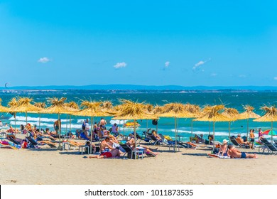 People are enjoying sunny day on a beach in the Bulgarian city Burgas.