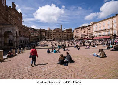 People enjoying in sunny day at Piazza del Campo, Siena, Italy on Easter day 20th April 2014.