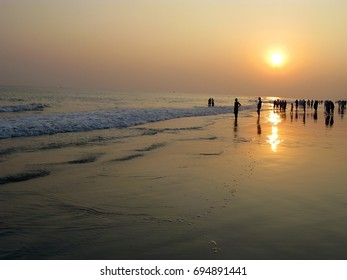 people enjoying sunset view in evening at puri sea beach Odisha India