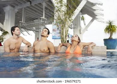 people enjoying swimming pool in resort