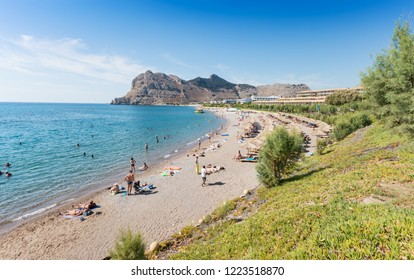 People enjoying their vacation on Kolymbia beach (Rhodes, Greece)