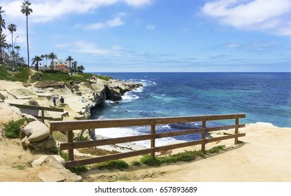 People enjoying the view at La Jolla cliffs in California