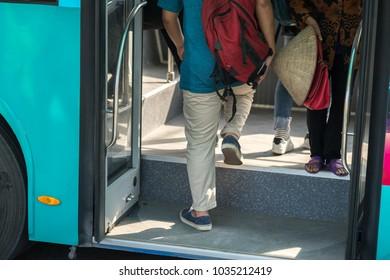 People entering bus closeup