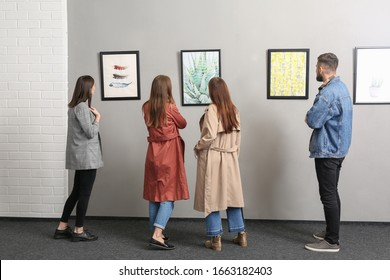 People at exhibition in modern art gallery