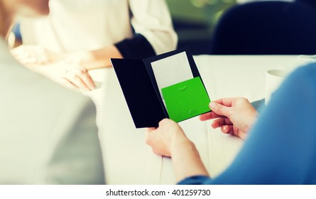 people, expenses, payment and lifestyle concept - close up of woman hands holding restaurant bill