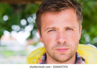 people facial expression concept . Close up portrait of serious smiling middle aged man face. He looked tired and sad