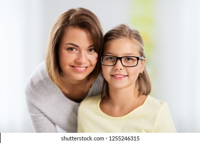 people and family concept - portrait of happy mother and daughter