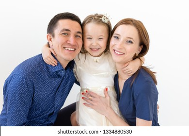 people, family and happiness concept - happy family with child on white background