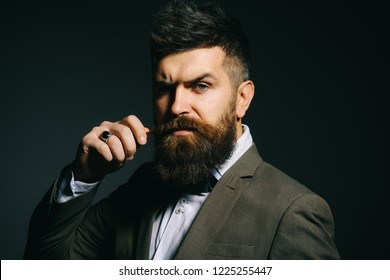 People in fashion treat it as a business. Bearded man after barber shop. Man with long beard in business wear. Business as usual. Mens fashion. Barber in shop.