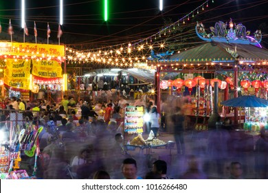People and festivals at night. PHICHIT THAILAND-DECEMBER 16: Many people are walking in the annual festival of night, with shops and beautiful lights.On December 16, 2017 in Phichit, Thailand.