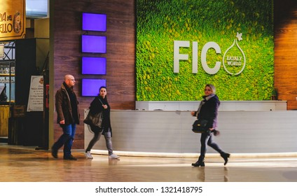 people at Fico Eataly World pass near the Fico help desk in Bologna, Italy, 24 Feb 2019