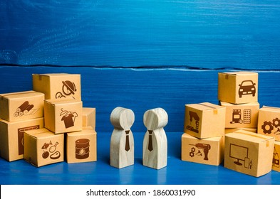 People figures conducting business negotiations and boxes. Trade goods and services, business process. Barter. Economy. Production and retail of products. Transportation, logistics and distribution.