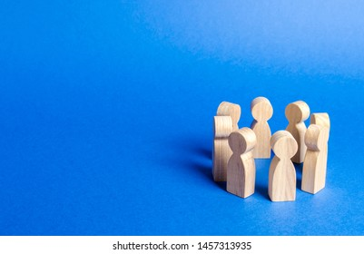 People figurines stand in a circle. discussion, cooperation. Meeting at work, negotiating a plan of action. teamwork. Society and community. Employees briefing. Organization of work and processes