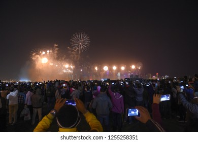 People are filming fireworks with mobiles, from Qatar National Day celebrations, Doha, Qatar, December 2015