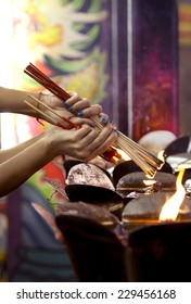 People fire joss stick and candle for pray in joss house at chinese new year.