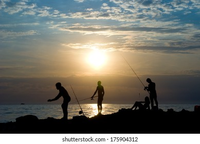 People fish. The sea, evening, the beautiful sky.