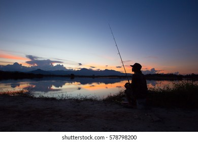 People fishing at dusk with beautiful light.