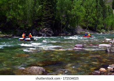 People float on a kayak on the mountain river