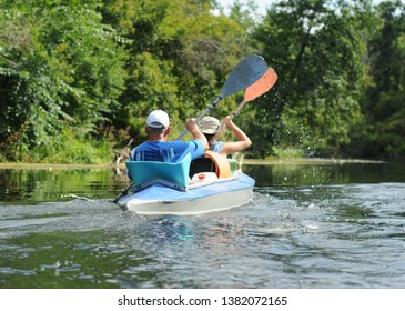 People float on the river in the canoe in the summer