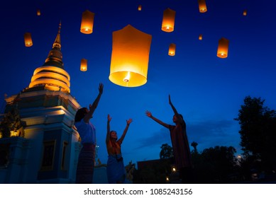 People floating lamp in Yi Peng festival in Chiangmai Thailand