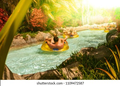 People floating on lazy river in Siam Park, Tenerife, Spain.