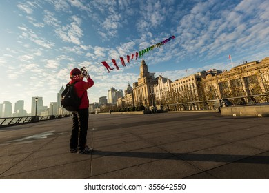 People flying kite at The Bund in Shanghai, China