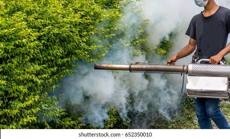 People fogging DDT spray kill mosquito for control Malaria, Encephalitis, Dengue and Zika in village at Bangkok Thailand.
