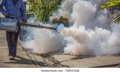 People fogging DDT spray for mosquito kill and protect by control mosquito is a carrier of Malaria, Encephalitis, Dengue and Zika virus in village.