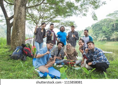 People Friendship Hangout Traveling Destination Camping Concept near lake