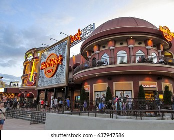 People in front of Hard Rock Cafe on April 15, 2017 in Orlando, Florida.  Hard Rock Cafe is a rock n roll themed restaurant located in Universal CityWalk.