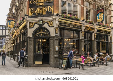 people in front at the terrace of a Typical old London Pub bar at Oxford street London UK June 2017