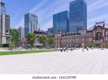 People in Front of the Tokyo Station and Big modern Skyscrapers in Summer in Japan 2018.