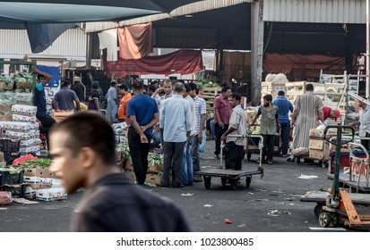 People gather at Manama's central market to buy and sell fruits and vegetables. Manama, Bahrain June 1, 2017