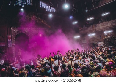 People gathered for Holi festival of colors celebration at Banke Bihari temple in sacred city Vrindavan, India. Circa March 2017