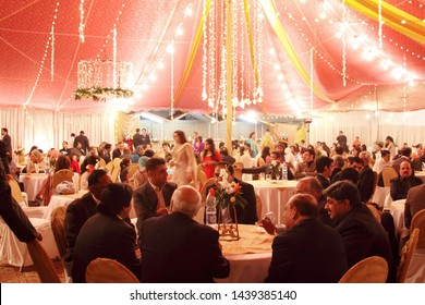 People gathered and sitting in wedding hall for dinner. Location: Lahore, Punjab, Pakistan. Date Taken: December 06, 2009.