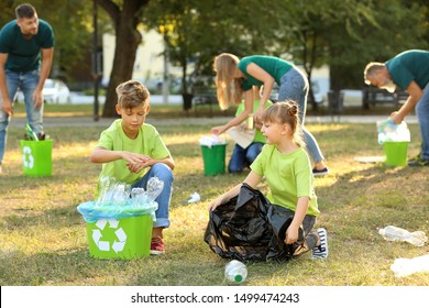 People gathering garbage outdoors. Concept of recycling