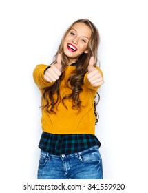 people, gesture, style and fashion concept - happy young woman or teen girl in casual clothes showing thumbs up
