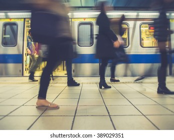 People getting off the subway train. Motion blur. City life. Retro effect.