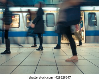 People getting off the subway train. Motion blur. City life. Toned image.