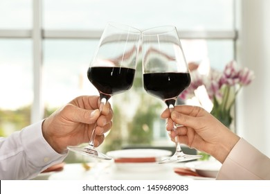 People with glasses of wine on blurred background, closeup