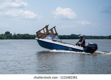 People go through the canals of Vilkovo, Odessa region, Ukraine, June 2018