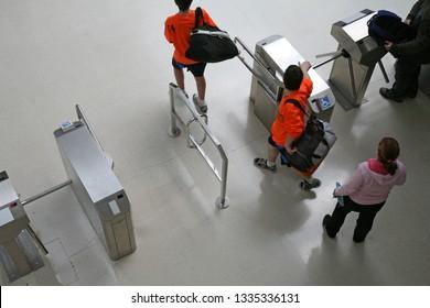people going through security doors