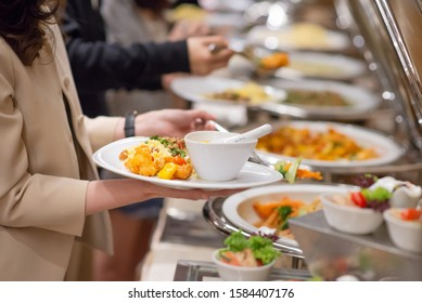 people grab some food on their own plate