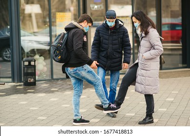 People greeting with foots. Alternative handshake during coronavirus epidemic. Covid 19. Coronavirus prevention. Non-contact greeting. Foot shake style of greetings. Coronavirus epidemic.
